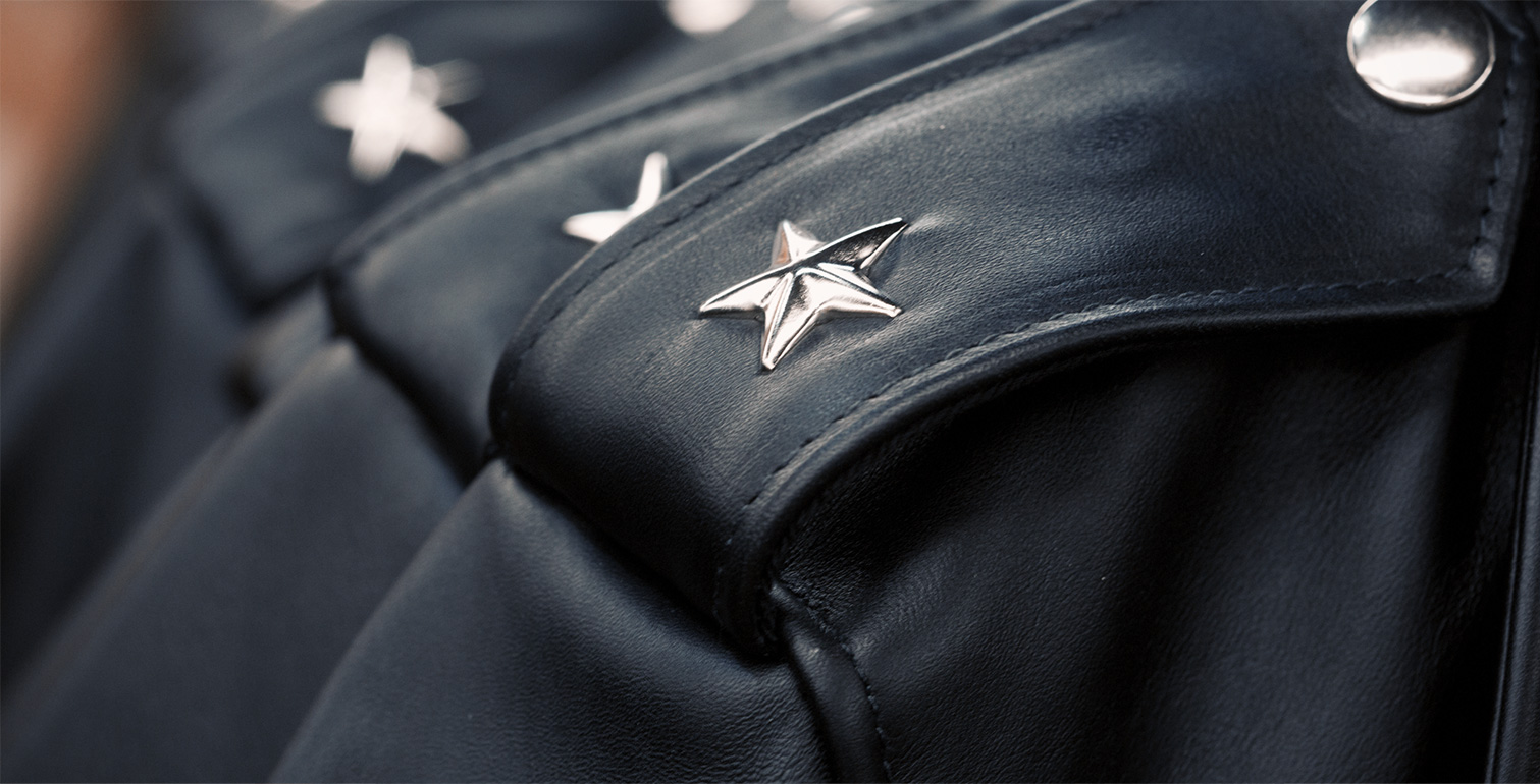 Star hardware details showing on a leather jacket