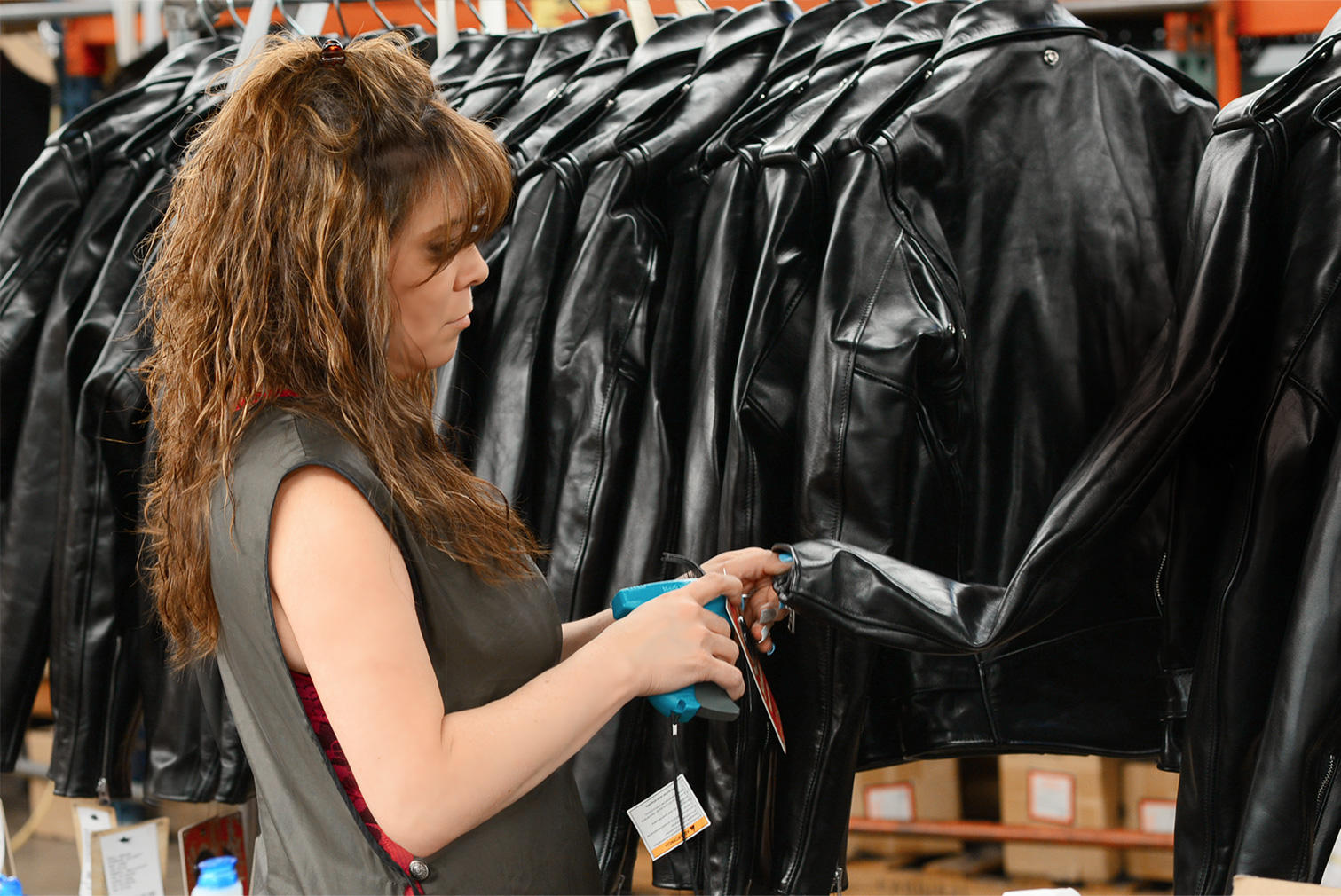 Woman at the Schott factory inspecting leather jackets